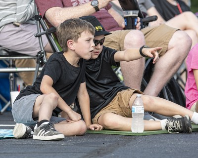 Young audience members watch Battle of the Bands