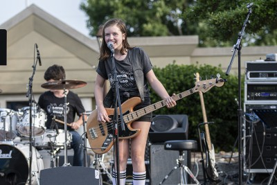 Female guitarist at Battle of the Bands.